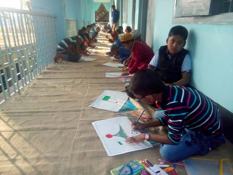 Students of an ENRICH Education Assistance Center are busy in a Drawing Competition organised to observe the Victory Day