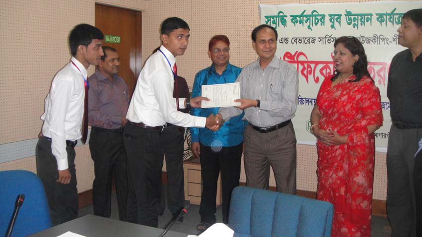 Md. Abdul Karim, MD of PKSF, handing over certificate to an ENRICH training participant