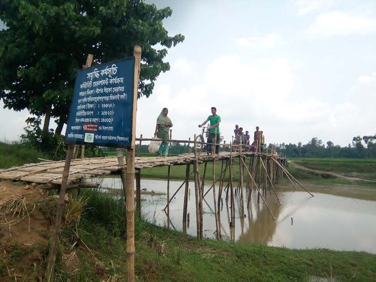 A wooden bridge constructed under the community-based development activities of ENRICH
