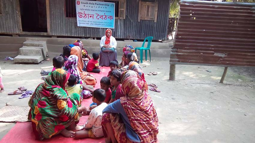 An ENRICH Health Assistant delivering health and nutrition-related messages to rural women at a yard meeting, popularly known as Uthan Boithok in Bangla