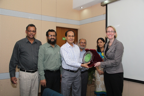 Managing Director of PKSF presents crest to Ms. Sarah Cooke, Country Representative of DFID Bangladesh
