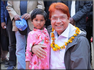 Dr Jashim Uddin poses with a girl child at Char Elahi EAC