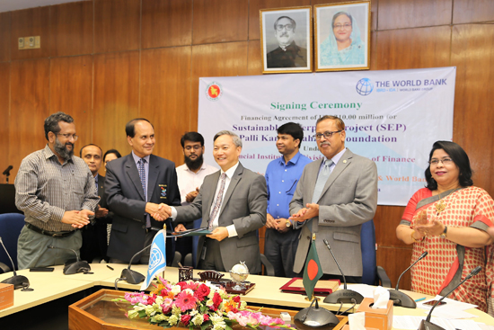 Signing of the Project Agreement by  Mr. Md. Abdul Karim, Managing Director, PKSF  & Mr. Qimiao Fan, Country Director of the World Bank in the presence of Mr. Kazi Shofiqul Azam, Senior Secretary, ERD & Mr. Md. Fazlul Kader, Deputy Managing Director of PKSF